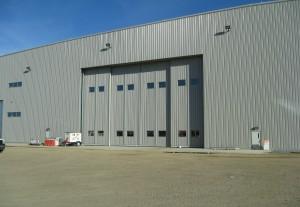 Metal building with sliding garage doors