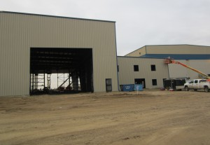 Adding finishing touches to a pre-fabricated metal building