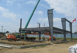 Erecting metal building with a crane