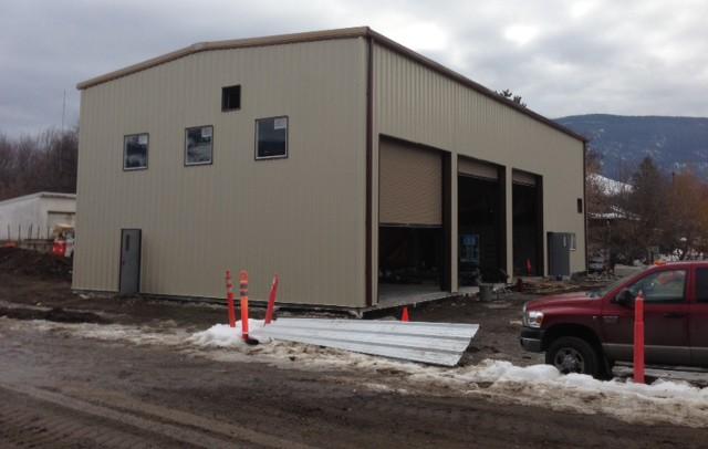 Metal building with garage doors